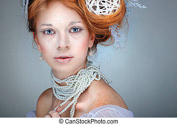 Redheaded girl with new-year decorations in a hair-do....
