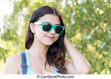 Portrait of teen girl in sunglasses on nature summer -...