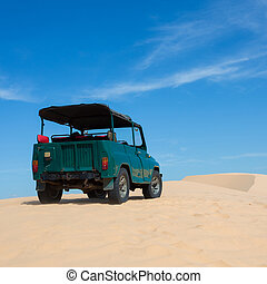 off road car vehicle in white sand dune desert at Mui Ne, Vietnam