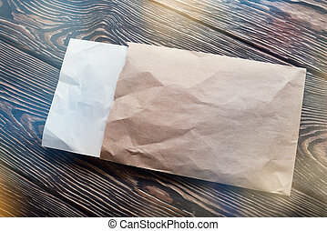 Open envelope on the table
