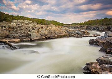 Long exposure of rapids in the Potomac River at sunset, at...