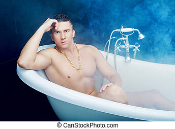 man takign a bath - attractive muscular yougn man taking a...
