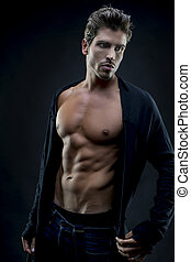 Muscular, Young fashion model with abdominals and stylish...