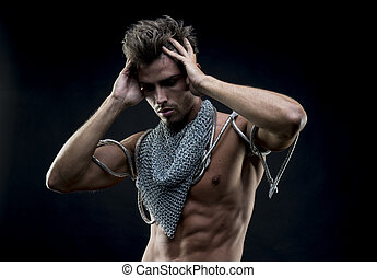 attractive naked man with abdominal, chain mesh medieval neck with metal snakes