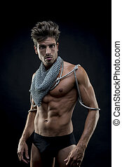 fitness, attractive naked man with abdominal, chain mesh medieval neck with metal snakes