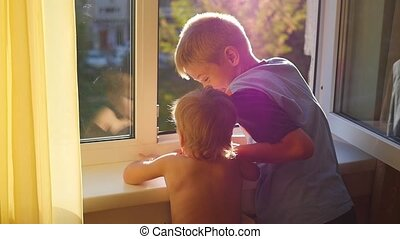 children look into the open window