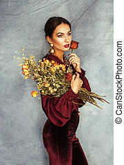 young attractive stylish brunette woman with bouquet of...