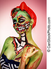 halloween look - Portrait of a pin-up zombie woman over pink...