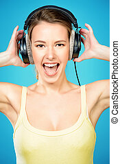 expressive young woman - Modern girl enjoys listening to...