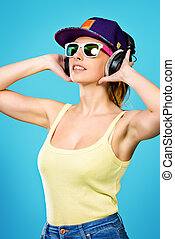 girl in headphones - Modern young woman enjoys listening to...