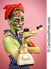 masquerade - Portrait of a pin-up zombie woman over pink...