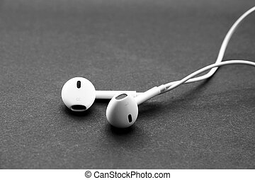 Headphones of white color isolated on black