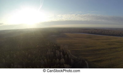 Breathtaking top view from balloon on green field -...