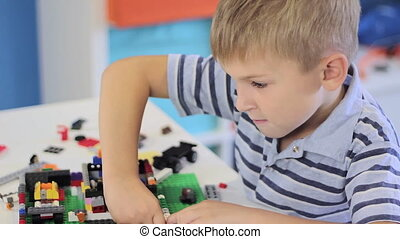 Child playing with a construction toy set