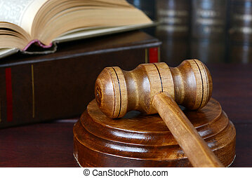 allegory of Justice - Wood gavel, soundblock and open book...