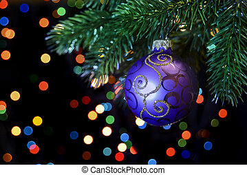 Christmas ball hanging on a Christmas tree branch - purple...