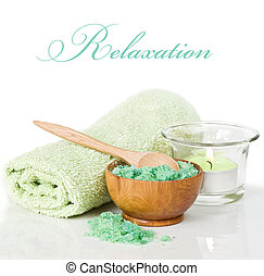 Spa treatment - Candlelit bath scene with towel