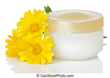 jar of cream and flowers - closed jar of cream and marigold...
