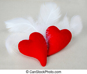 wings of love - Pair of scarlet fluffy hearts among fluffy...