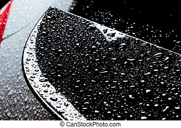 Rain water drops on car body black red