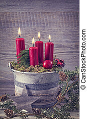 Four red christmas candles