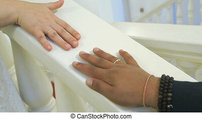 Hands's newlyweds are bonded together gliding on the white...
