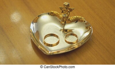 Wedding rings on the saucer in a registration hall - Gold...