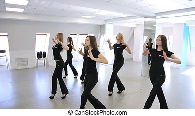 Young females are dancing in model school.
