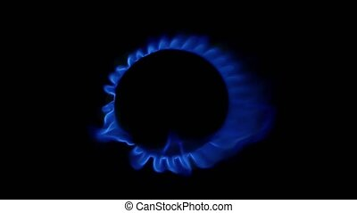 Wind blows on a gas burner. Close up - Wind blows on a gas...