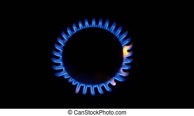 Turn on gas burner Close up - Turn on gas burner, fire, blue...