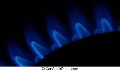 Blue flame from a gas burner. Close up - Blue flame from a...