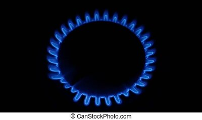 Natural gas stove burner blue flame. Close up - Natural gas...