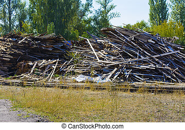 A pile of old boards in an abandoned factory in the industrial zone