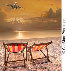 beach chairs at sea beach and passenger plane flying above