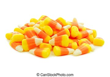 Pile of Halloween candy corn over a white background
