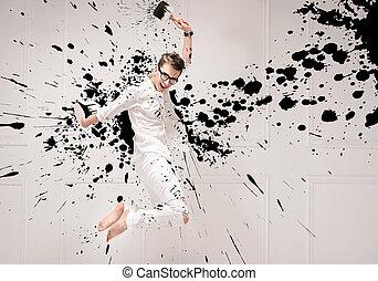 Conceptual portrait of a jumping painter - Conceptual...