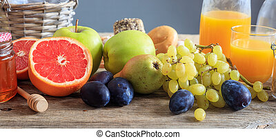 Variety of fresh fruits on a wooden table