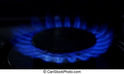 Gas burner burns with a blue flame. Close up. Slow motion -...