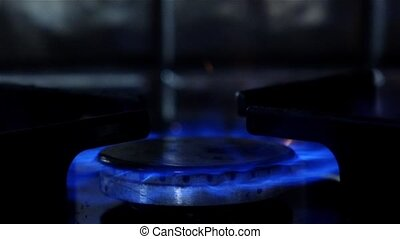 Gas burners in the kitchen oven. Close up. Slow motion