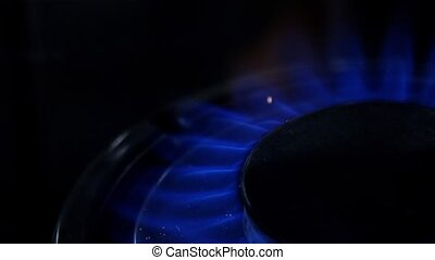 Turn on gas burner. Close up. Slow motion - Turn on gas...
