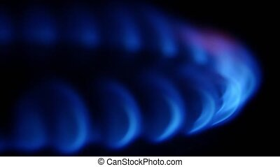 Gas burner shuts down slowly. Close up - Gas burner shuts...