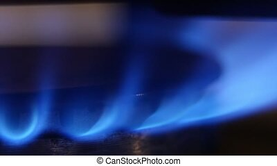 Strong flame on a gas burner. Close up - Strong flame on a...