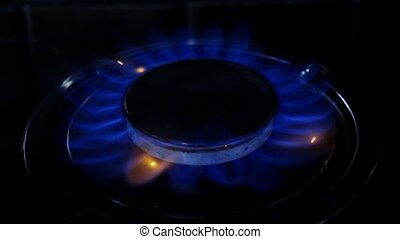 Gas burner flame. Close up. Slow motion - Gas burner flame,...