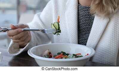 Healthy lifestyle woman eating salad smiling happy outdoors...