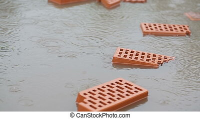Bricks in a puddle in the rain