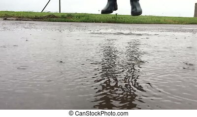 jumping in a puddle slow motion