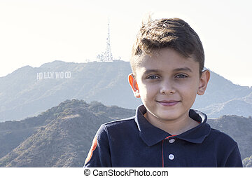 Handsome boy with Hollywood sign