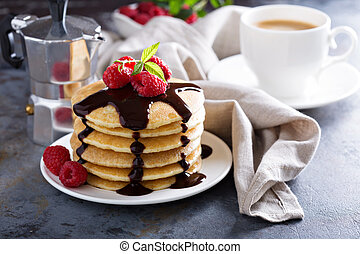 Stack of fluffy buttermilk pancakes with fresh raspberry and...
