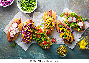 Variety of hot dogs with healthy garnishes - Variety of hot...
