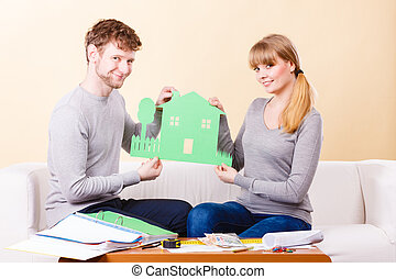 Young couple planning future - Future family real estate...